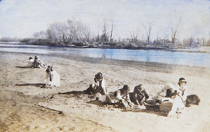 "From my Grandmothers album.  A beautiful day in the life of a group of young woman making sand castles along the river. They're all long gone now, all that remains is this photo, of a wonderful moment in time. ""And so castles made of sand, melts into the sea eventually""  Jimi Hendrix"
