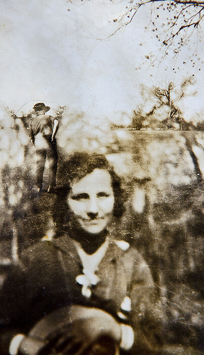 I find this shot particularly  haunting. It appears to be an accidental double or triple exposure. I love the gesture of the man with his back to us, the soft figure of another person just above her shoulder and the tree of the promised land in the distance.  The smile of a young woman, my Grandmother, full of hopes and desires. This photo has a very dream like quality to it. The layers of images from a distant era transposed upon one another. Like peering into a crystal ball.