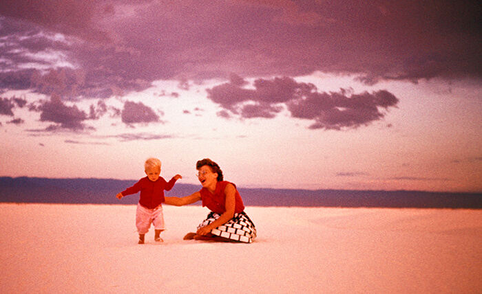 One of my all time favorite photographs. My Mother and older sister, taking some of her very first steps. The surreal colors and location, the loving gesture of a mother and her first child. There is something almost post apocalyptic about it, both beautiful and haunting.             White Sands NM about 1954.